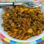 Pasta in red sauce with vegetables - This is a quick version of pasta cooked in red sauce along with some vegetables. Ideal for a quick dinner or even as a quick snack for the kids.