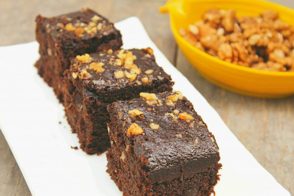 Moist Chocolate Walnut Cake - Amazing combination of chocolate and walnuts in form of a cake. This easy chocolate walnut cake recipe would surely become your one of the favorite eggless cake recipes. Just give it a try!