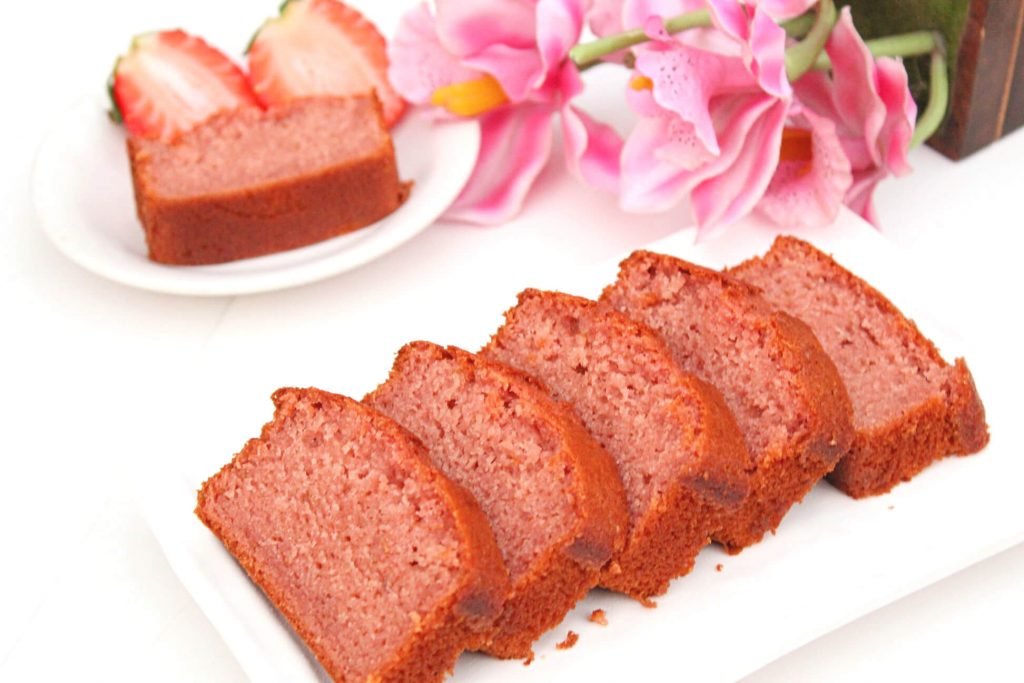 Eggless Strawberry Cake : An eggless strawberry cake with fresh strawberries. This cake is moist, soft and has an amazing taste of real strawberries!